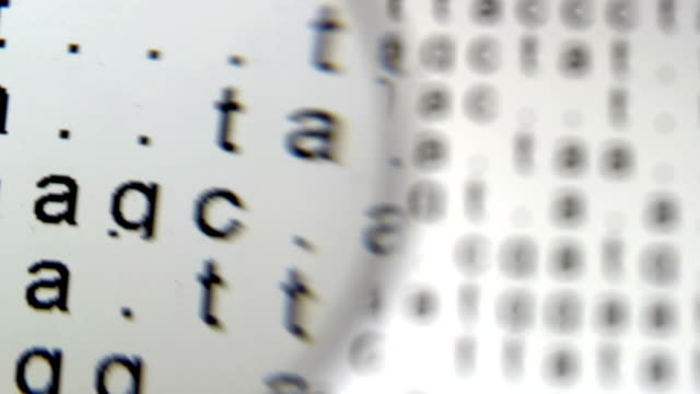 dna sequence in the background under magnifier glass - dna test stock videos and b-roll footage