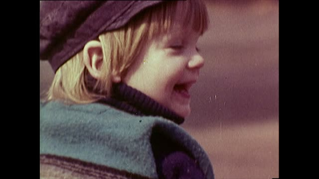 sequence of 1960's male toddler in playground - cap stock videos & royalty-free footage