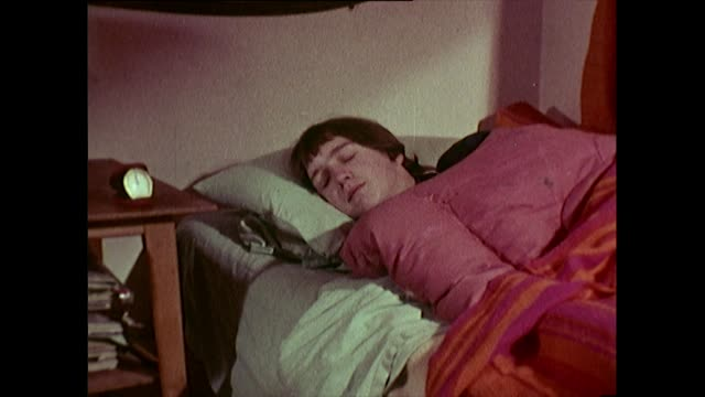 sequence of 1960's teen boy being lazy in bed - faulheit stock-videos und b-roll-filmmaterial