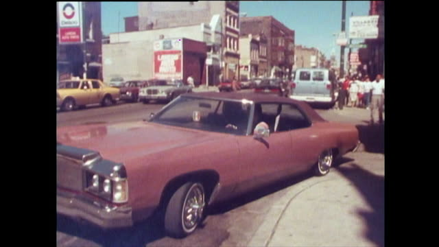 sequence of a low rider car in hispanic area of chicago; 1989 - chicago 'l' bildbanksvideor och videomaterial från bakom kulisserna