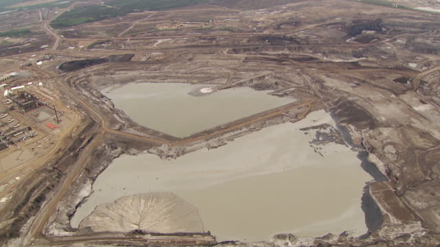 Sequence of aerial shots over the Athabasca oil sands refinery in Alberta, Canada.
