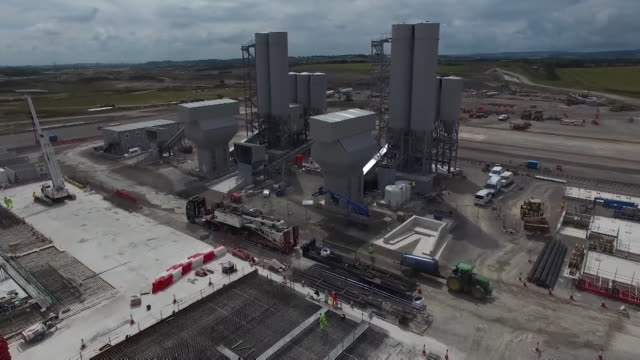 sequence of aerial views showing the construction of hinkley point c nuclear power station at hinkley point, somerset, uk. - atomkraftwerk stock-videos und b-roll-filmmaterial