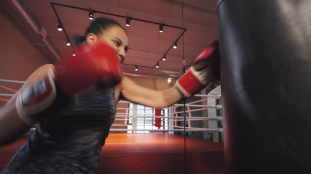 sequence of african american woman having boxing workout in gym - film montage stock videos & royalty-free footage