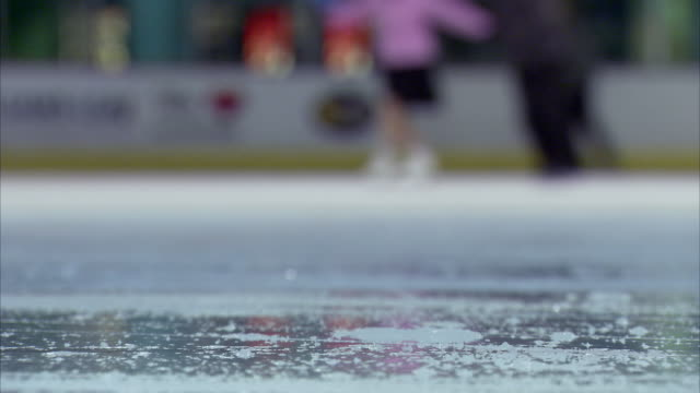 sequence of anonymous ice skaters - menschliche gliedmaßen stock-videos und b-roll-filmmaterial