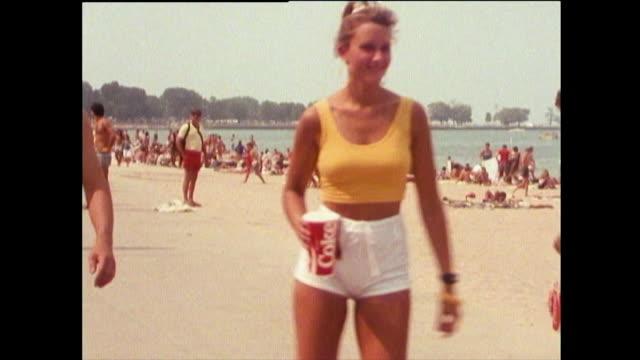 sequence of beach gvs of lake michigan; 1989 - stillastående vatten bildbanksvideor och videomaterial från bakom kulisserna