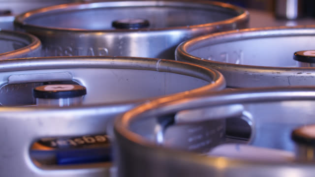sequence of beer kegs lying in storage - keg stock videos and b-roll footage