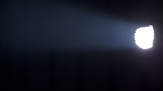 a sequence of blinding flashes as the camera crosses a beam of natural light in a smoky foundry, uk. - smoke physical structure stock videos & royalty-free footage