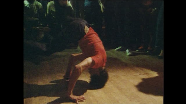 sequence of breakdancers on dancefloor; new york, 1984 - showing off stock videos & royalty-free footage