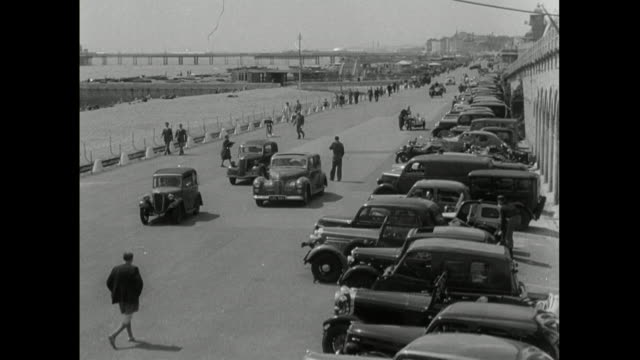sequence of brighton seafront and beach on bank holiday; 1950 - walking in water stock videos & royalty-free footage