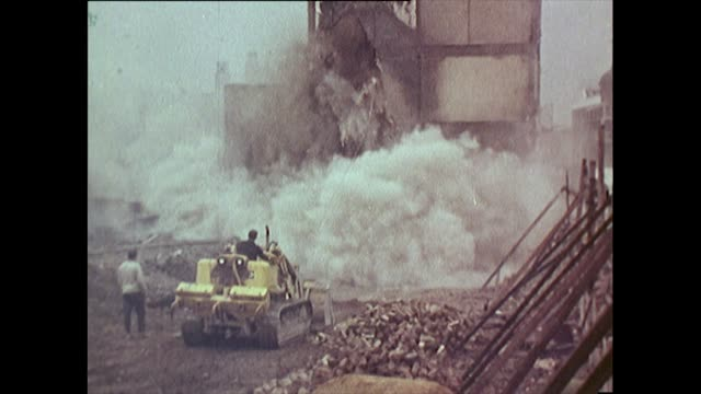 sequence of building demolition and tilt of new tower block in 1960's liverpool - demolishing stock videos & royalty-free footage