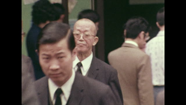 sequence of businessmen and women in hong kong; 1972 - employment issues stock videos & royalty-free footage