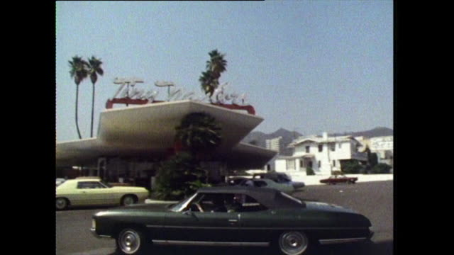 sequence of cars and people at drive-in diner; 1972 - fast food stock videos & royalty-free footage