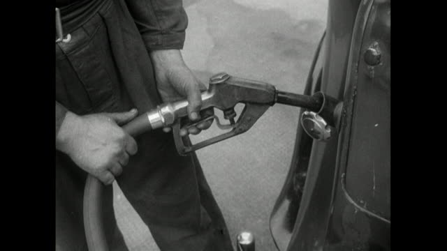 cu b&w sequence of cars being refuelled at petrol station; 1950 - oil industry stock videos & royalty-free footage