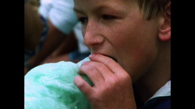 sequence of children eating candy floss and rock; 1986 - east sussex stock videos & royalty-free footage