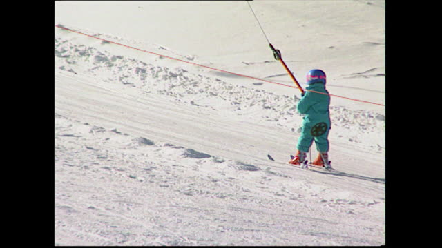 sequence of children skiing on snowy slopes; 1993 - ski lift stock videos & royalty-free footage