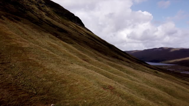 sequence of drone shots of the rolling hills of the scottish highlands - scottish culture bildbanksvideor och videomaterial från bakom kulisserna
