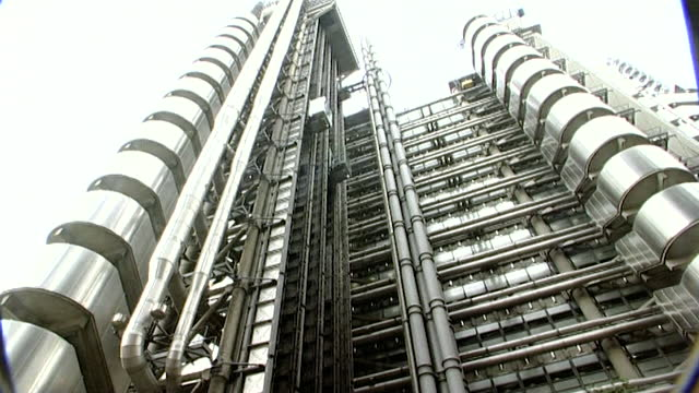 sequence of exterior shots of lloyds of london building in the city of london on the day after the 9/11 attacks; 2001. pan right over metallic... - silver coloured stock videos & royalty-free footage