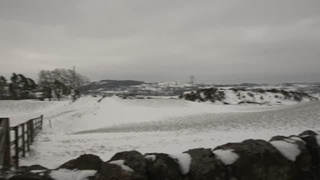 vídeos de stock, filmes e b-roll de sequence of external shots of the countryside in renfrewshire scotland - chuva congelada