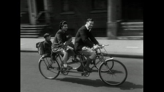 vídeos y material grabado en eventos de stock de sequence of families riding bicycles together; 1950 - bicicleta antigua