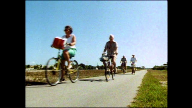 sequence of gvs of tourists cycling in florida; 1991 - number 4 stock videos & royalty-free footage