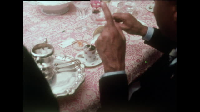 sequence of hand with drinks at a dinner party; 1970 - マナー点の映像素材/bロール