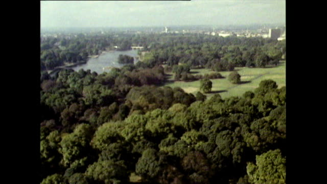 sequence of high angle shots of hyde park in 1971 - horizon over land stock videos & royalty-free footage