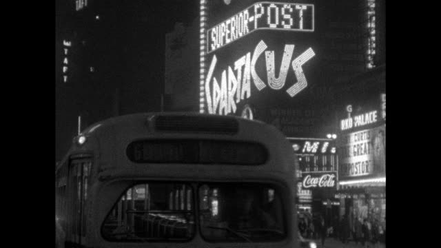 vídeos de stock e filmes b-roll de sequence of illuminated billboards on broadway; 1961 - advertisement