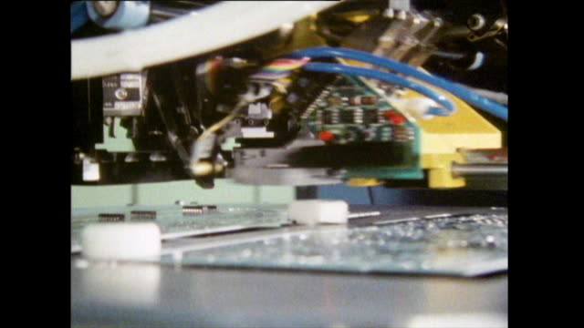 cu sequence of machine assembling circuit board; 1986 - computer chip stock videos & royalty-free footage