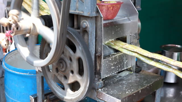 sequence of making sugar cane juice and a man drinking - sugar cane stock videos and b-roll footage