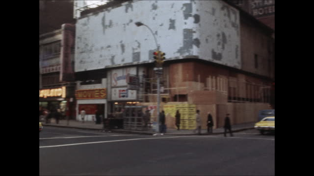 vidéos et rushes de sequence of marquees along 42nd street showing the happy hooker and other adult films. - manhattan
