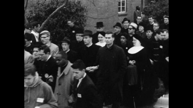 stockvideo's en b-roll-footage met sequence of medium shots showing a protest march leaving selma in alabama made up of black african americans, white sympathisers and members of the... - 1965