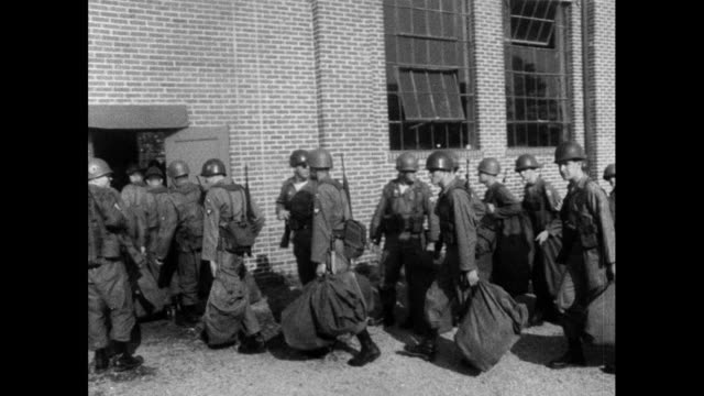 sequence of medium shots showing uniformed soldiers from the alabama national guard carrying their packs into a building during the selma to... - alabama us state stock videos & royalty-free footage