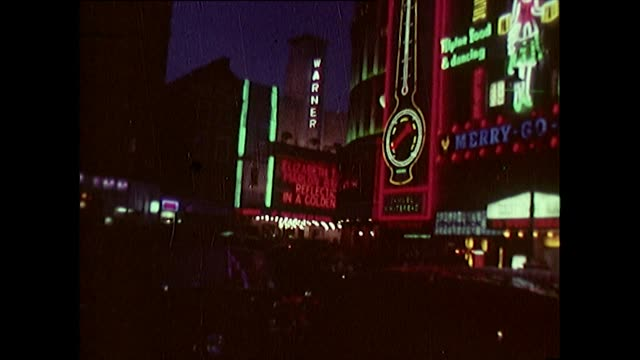 sequence of neon signs at night in uk cities - female likeness stock videos & royalty-free footage