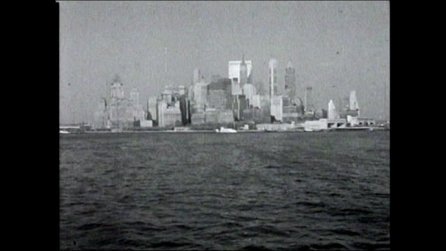 sequence of new york city skyline and buildings from river - b roll stock videos & royalty-free footage