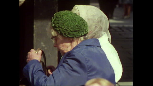 sequence of older couples outside in glasgow; 1976 - gossip stock videos & royalty-free footage