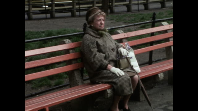 sequence of older women sitting on benches in manhattan; 1971 - general view stock videos & royalty-free footage