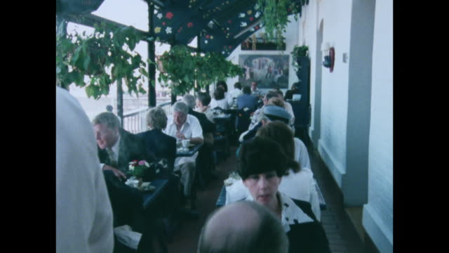 vídeos de stock e filmes b-roll de sequence of people dining in san francisco; 1979 - 1970 1979
