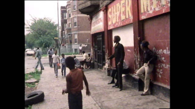 sequence of people in poor area of chicago; 1979 - poverty stock videos & royalty-free footage