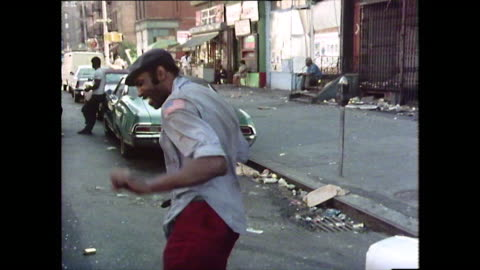 sequence of people living in harlem, new york; 1976 - archivmaterial stock-videos und b-roll-filmmaterial