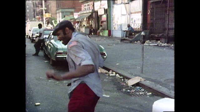 sequence of people living in harlem, new york; 1976 - bbc archive stock-videos und b-roll-filmmaterial