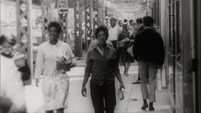 b&w sequence of people on streets in chicago; 1964 - 1964 stock videos and b-roll footage