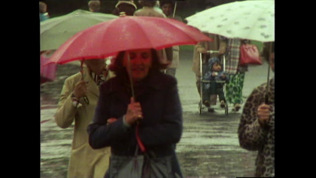 sequence of people walking in the rain with umbrellas - rain stock videos & royalty-free footage