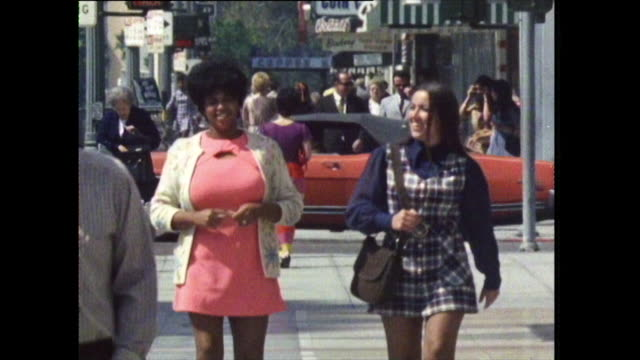 sequence of people walking on los angeles' streets; 1972 - mini skirt stock videos & royalty-free footage