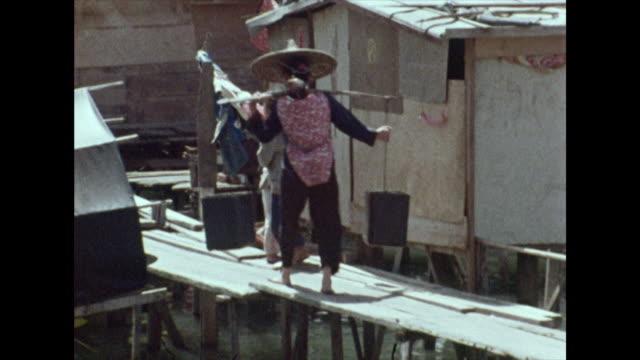 sequence of people working in rural hong kong; 1972 - oar stock videos & royalty-free footage