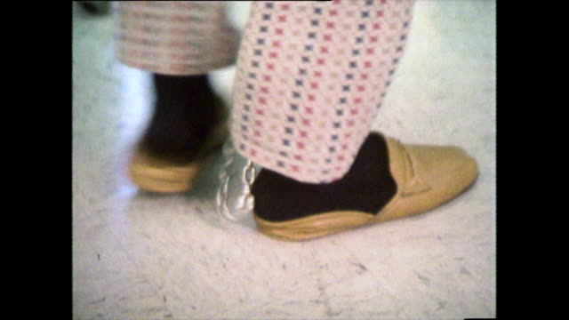 cu sequence of prisoner's shackled feet in hospital; 1979 - slipper stock videos & royalty-free footage