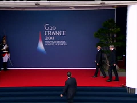 a sequence of shots of canadian prime minister stephen harper arrival at g20 summit cu gets out of the car walks past the world flags waves and ws... - business or economy or employment and labor or financial market or finance or agriculture stock videos & royalty-free footage