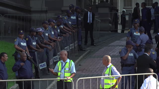 sequence of shots showing armed police outside durban high court, kwazulu-natal - b roll stock videos & royalty-free footage
