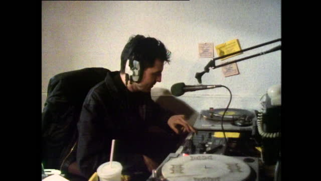 sequence of shots showing dj tim westwood hosting a pirate radio show in the early days of his career; 1987. - cool attitude stock videos & royalty-free footage