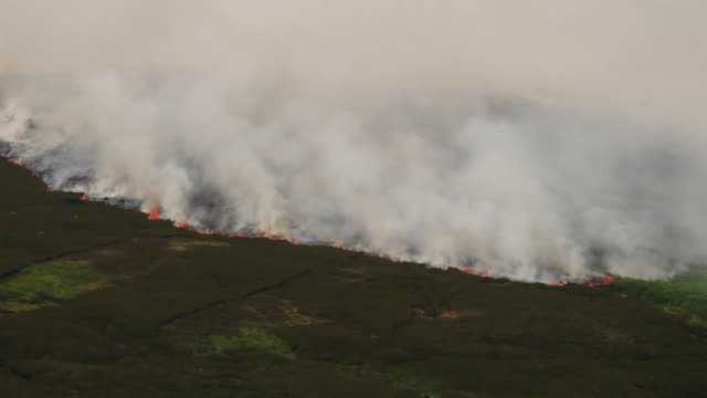 Sequence of shots showing fire spreading across Saddleworth Moor in Greater Manchester