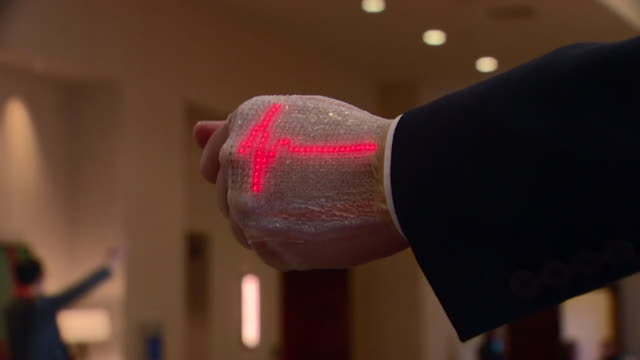 sequence of shots showing newly developed wearable sensors to aid stroke patients in recovery - medizinisches gerät stock-videos und b-roll-filmmaterial